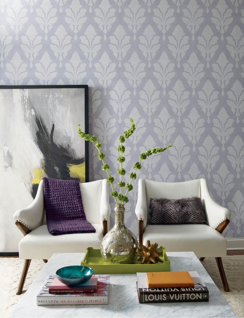Oversized fleur-de-lis make a stunning impact on this contemporary textured wallpaper from Stacy Garcia | New York's Paper Muse Collection for York Wall Coverings. More than twenty inches tall, the French symbol cascades across the paper on thin, crosshatched stitching resembling cloth. Eight diverse color options include navy in a light, medium, and dark tone or white with pale grey and bright limeade.