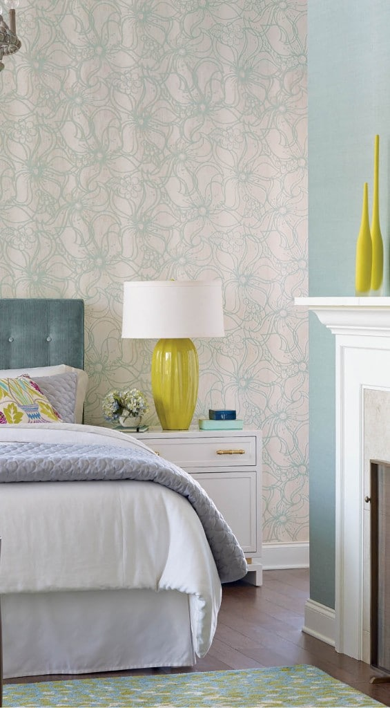 Whimsical Bloom from Stacy Garcia | New York's Paper Muse Collection for York Wall Coverings features large stylized outlines of wispy flower petals intermingled over a vertical striae background. The blossoms have slender, elongated serpentine petals and are available in five selections including cream with beige, sunshine yellow, and metallic silver.