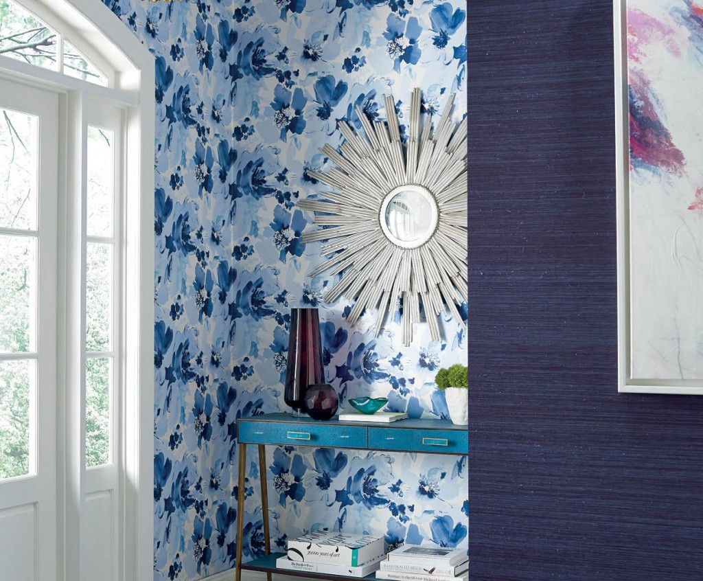 Aquarella from Stacy Garcia | New York's Paper Muse Collection for York Wall Coverings features a watercolor of oversized flower blooms atop a matte white or pearlescent background. Six color stories range from sea blues to a deep purples with hints of peach, painted in translucent to opaque blended inks. Reminiscent of an artist's brush strokes, the blooms stretch up to ten inches in diameter offering a touch of feminine whimsy.