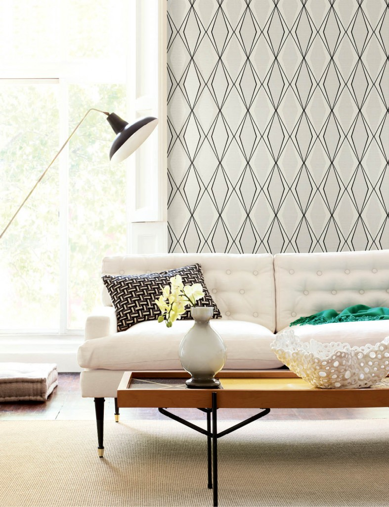 Facet from Stacy Garcia | New York's Paper Muse Collection for York Wall Coverings commands attention with oversized concentric diamonds. Resting atop miniature metallic diamonds, the wallcovering adds a striking postmodern and contemporary aesthetic to any residential setting. This pattern is available in five shades including midnight blue with light blue and silver or white with ebony and silver.