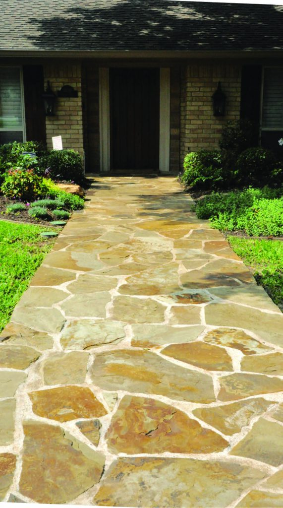 A new walkway draws the eye and beckons guests into the home.