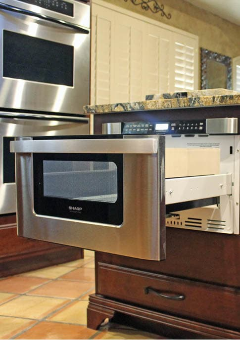 This sliding under-counter microwave neatly rolls out of sight. Photo courtesy Sam Ferris, Tukasa Creations.