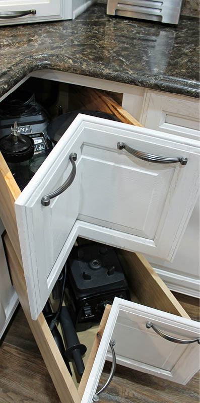 Corner cabinets provide inventive storage space. Photo courtesy Sam Ferris, Tukasa Creations.