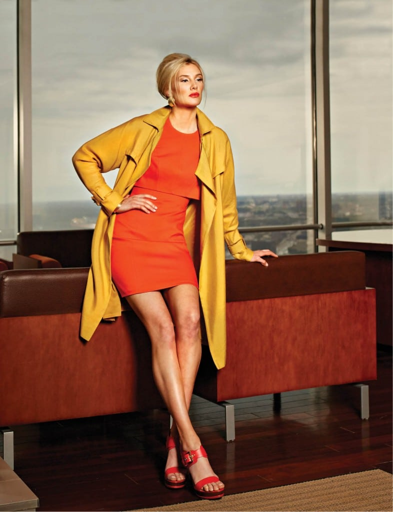 Classiques Entier yellow gold canvas trench coat, $458: Nordstrom. Karen Miller orange sheath dress, $250:  Karen Miller.  Robert Lee Morris gold cuff, $60: Macy's.   Round hammered earrings, $8: Aldo.
